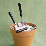 Use builders sand to keep gardening tools from rusting.