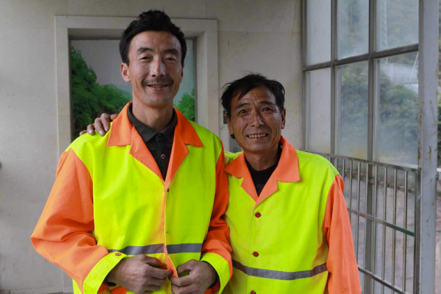 Here are Liu Jiancheng and Zhang Chengqing, unmasked, smiling, and rightfully proud of the work they do everyday.