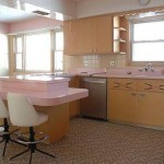 The kitchen as a whole, just as it appeared when the house was built more than 50 years ago. The theme is pink!
