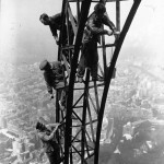 Painting the Eiffel Tower, 1932.