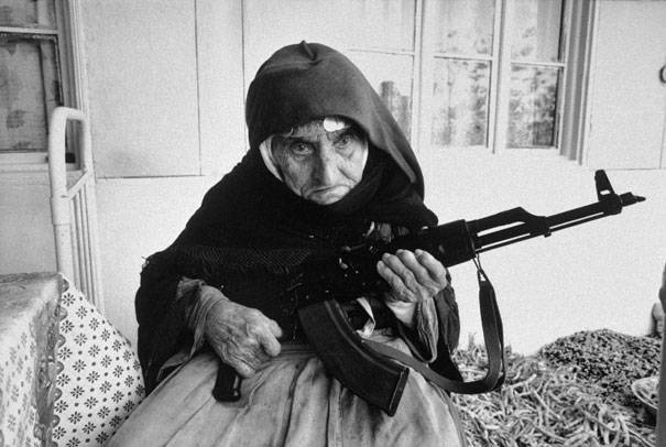 106-year-old Armenian woman guards her home in 1990.
