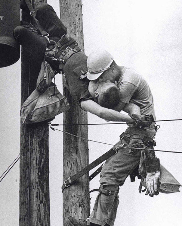 A utility worker giving mouth-to-mouth to a co-worker after he contacted a high voltage wire in 1967.