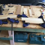Here, different sections of the shelf are in vices, ensuring the glue dried and the components were sturdy.