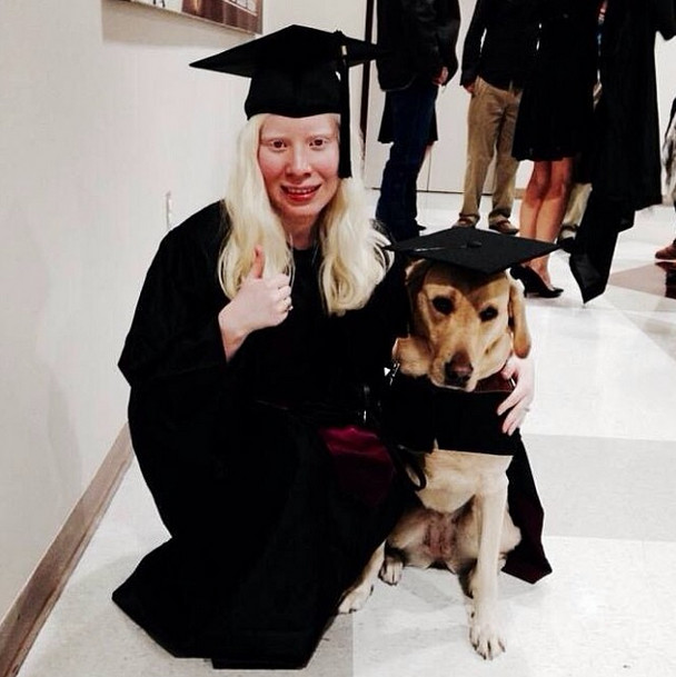This pup helped his human graduate! He kills it in a cap and gown.