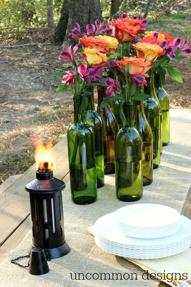 Use wine bottles as vases for gorgeous flower arrangements.