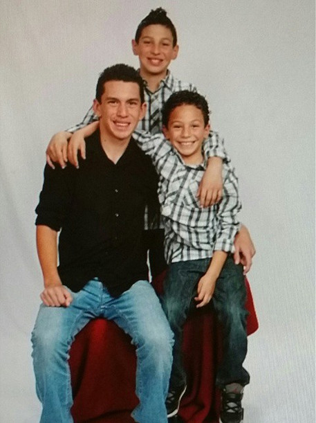 On the left is Joey, 14, with his two younger brothers.