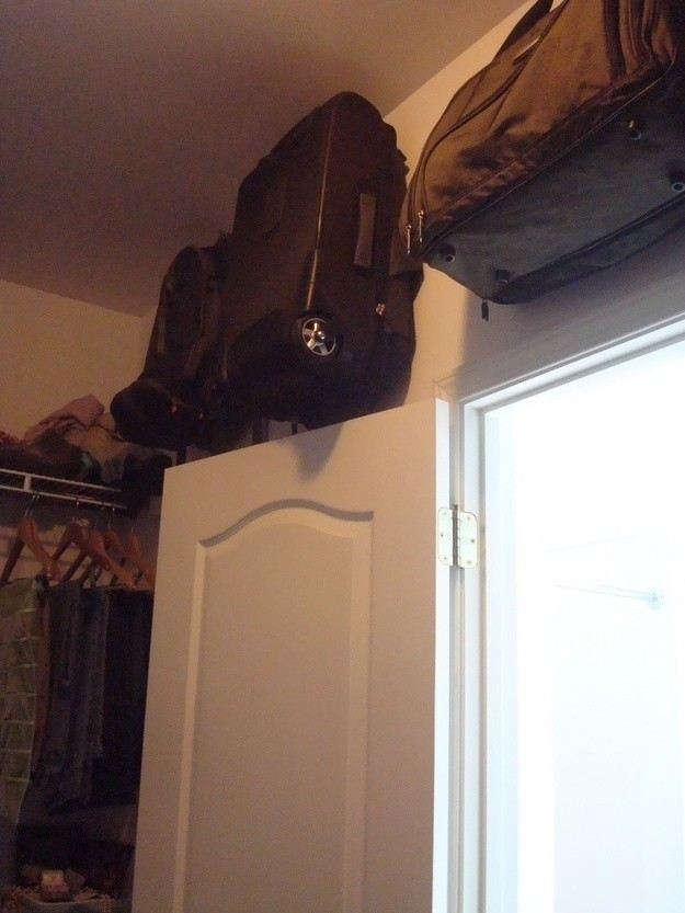 Hang empty suitcases off the ground to save floor space.