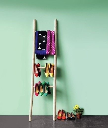For a rustic look, an old ladder can hold your heels, scarves, and other clothing items.