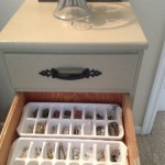 Ice cube trays make for excellent jewelry organizers.