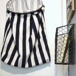 Suspend your laundry basket on a door to save floor space.