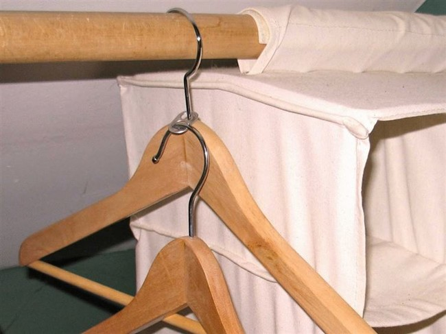 Use a soda can tab to make more room in your closet by attaching another hanger to it.