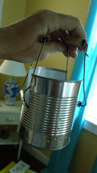 Finally, put the handles you created around the flaps. You now have ourself a tin can stove!