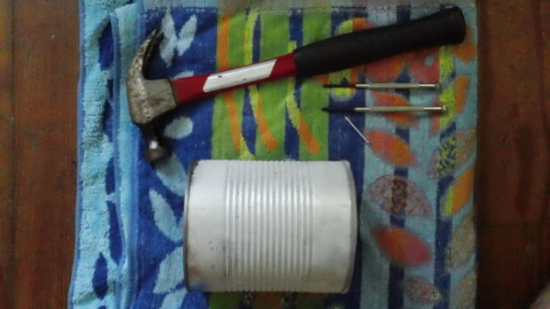 Use a hammer and nails to punch ventilation holes into the can.