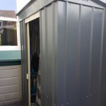 First he had to get everything out of it, so he built a shed to store the overflow.