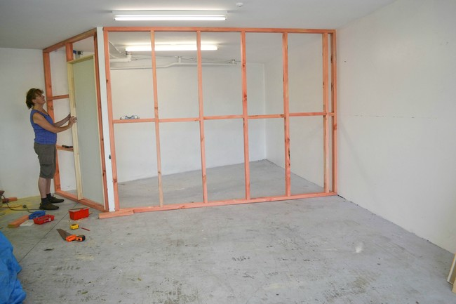 She began by constructing walls that would create multiple rooms in the space.