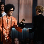 "LOS ANGELES, CA - FEBRUARY 08:  Musician Beck (R) accepts the Album of the Year award for ""Morning Phase"" from musician Prince onstage during The 57th Annual GRAMMY Awards at the at the STAPLES Center on February 8, 2015 in Los Angeles, California.  (Photo by Kevork Djansezian/Getty Images)"