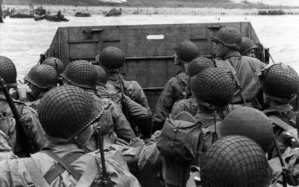 This photo taken on an landing craft on D-Day gives us a quick glimpse of a soldiers perspective while approaching the beaches at Normandy.