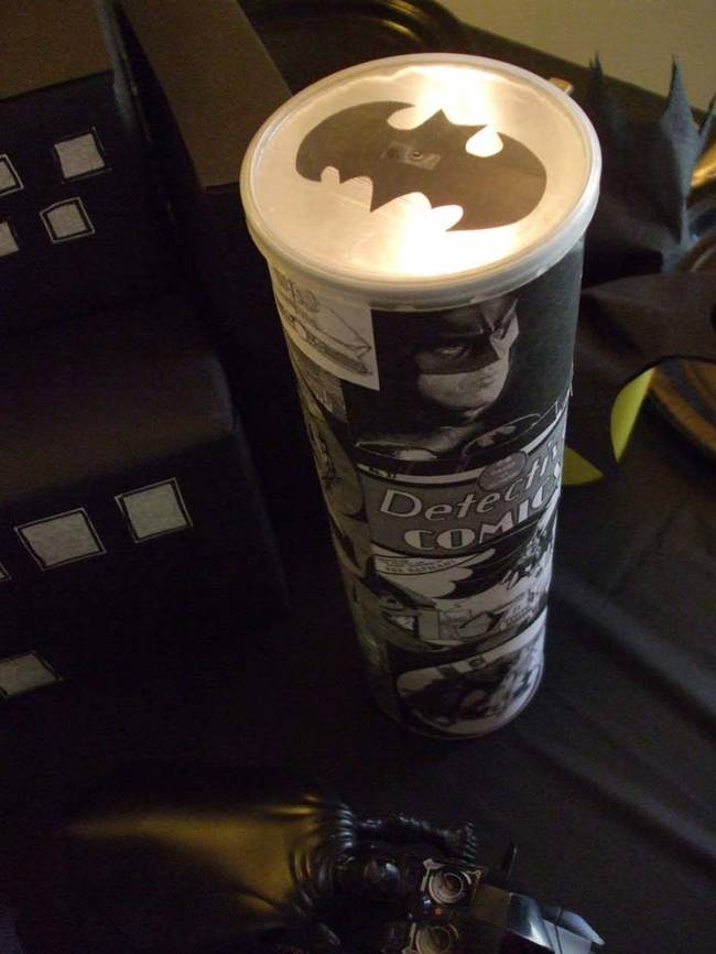 Make a bat signal out of a Pringles can and a flashlight. Check out the tutorial <a href=