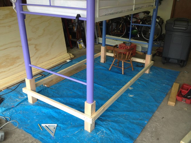He began by propping up the legs of the bed to attach additional wood that would make the frame the appropriate height.