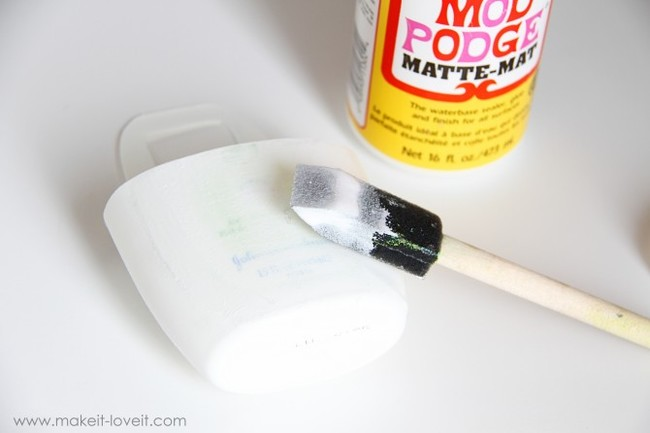 Coat the plastic with a crafting adhesive like Mod Podge.