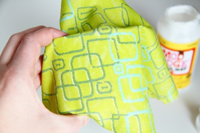 Place the fabric on top.