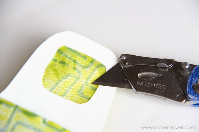 After that, use the craft knife to trim away unsightly edges. You should also cut out the fabric that covers the square opening on the back.