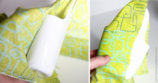 Repeat the process on the back and sides, making sure to pull the fabric down around the entire bottle.