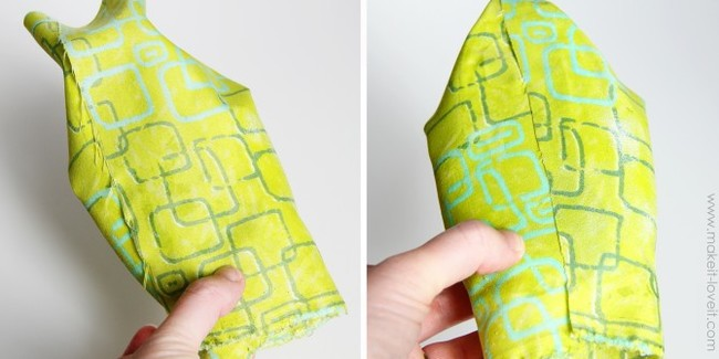 Trim away any excess fabric on the back, and cut out the fabric covering the opening on the front. Try to get as close to the edges as you can.