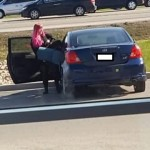 Here's a picture of that fraudulent panhandler getting into her car.