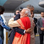 President_Barack_Obama,_with_First_Lady_Michelle_Obama,_greets_Prime_Minister_Narendra_Modi_upon_arrival_at_Air_Force_Station_Palam