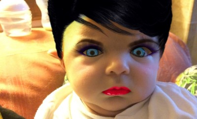 funny baby in Dracula style with makeup